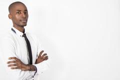 Czarny biznesowy mężczyzna na odosobnionym tle Zdjęcie Royalty Free
