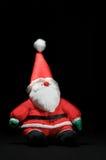 czarny Claus Santa obsiadania powierzchnia czarny Fotografia Royalty Free