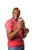 czarny człowiek trzyma piłkę Obraz Stock