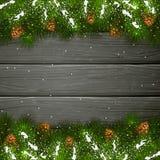 Czarny drewniany tło z Bożenarodzeniowymi jedlinowymi gałąź i sno Zdjęcie Stock