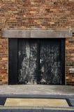 Czarny dwoisty tylnymi drzwiami Obraz Stock