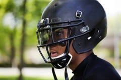 czarny futbolowego hełma mężczyzna profilu potomstwa obraz stock
