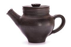 Czarny gliniany teapot Obrazy Royalty Free