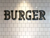 Czarny hamburgeru znak wśrodku restauraci zdjęcia stock