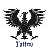 Czarny heraldyczny orzeł z szeroko rozpościerać skrzydłami Fotografia Royalty Free