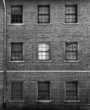 Czarny i biały fotografia ceglana fasada z okno Obraz Royalty Free