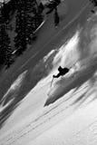 Czarny i biały narciarka. Obrazy Royalty Free