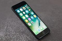 Czarny iPhone 7 na kamiennym tle Obraz Stock