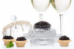 Czarny kawior i szampan odizolowywający Fotografia Stock