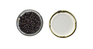 Czarny kawior w słoju na bielu Zdjęcia Royalty Free
