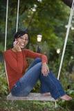czarny komórki outside telefonu kobieta Zdjęcia Royalty Free