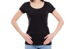 Czarny koszulka egzamin pr?bny w g?r? kobiety odizolowywaj?cej na bielu zdjęcia stock