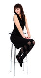 czarny krzesła sukni dziewczyny wysoki obsiadanie obraz stock