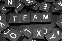 Czarny list tafluje literować x22 & słowo; team& x22; Fotografia Royalty Free