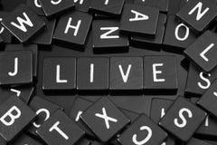 Czarny list tafluje literować x22 & słowo; live& x22; Obraz Royalty Free
