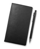 Czarny notatnik i ołówek odizolowywający na białym tle, corporat Fotografia Stock