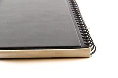 Czarny notatnik na białym tle Obrazy Stock