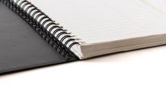 Czarny notatnik na białym tle Obrazy Royalty Free