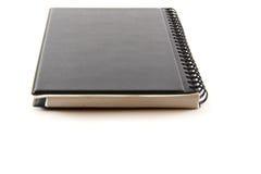 Czarny notatnik na białym tle Zdjęcia Stock
