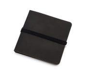 Czarny notatnik odizolowywający nad bielem Zdjęcie Royalty Free