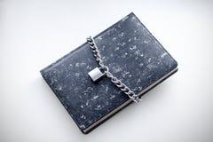 Czarny notatnik z kłódką Obrazy Stock
