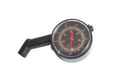 Czarny opona ciśnieniowy wymiernik. obraz stock