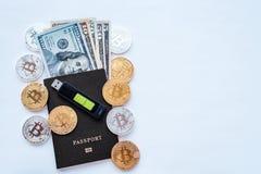 Czarny paszport, biały tło, tożsamości potwierdzenie USA dolary USD, metal monet złota srebra bitcoin, crypto Zdjęcie Stock