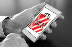 Czarny Piątku pojęcie na smartphone zdjęcia stock