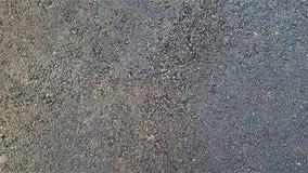 Czarny prostacki asfaltowy real textured tło z błękitnymi półgłosami fotografia royalty free