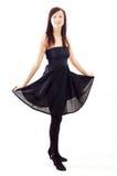 czarny przypadkowej sukni dziewczyny target607_0_ zdjęcie royalty free