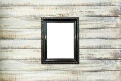 Czarny Rocznika obrazka rama na starym drewnianym tle Zdjęcia Royalty Free
