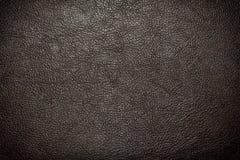 Czarny rzemienny tło lub tekstura Obrazy Stock