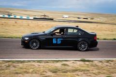 Czarny samochodowy ścigać się na śladzie Zdjęcie Royalty Free