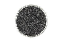 Czarny silikonowego karbidu proszek w szklanym zbiorniku obrazy stock
