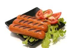 czarny statek pieczeń kiełbas pomidorów Fotografia Stock