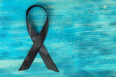 Czarny symbol walka przeciw czerniakowi i skóra nowotworowi zdjęcia royalty free