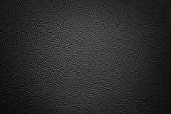 Czarny syntetyczny rzemienny tło z winietą Obraz Royalty Free