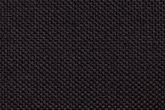 Czarny tło z galonowym w kratkę wzorem, zbliżenie Tekstura tkactwo tkanina, makro- Obrazy Royalty Free