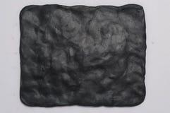 czarny tło plastelina Zdjęcie Stock