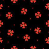 Czarny tło z czerwonymi kwiatami Obrazy Stock