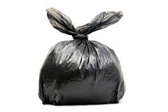 Czarny torba na śmiecie odizolowywający na bielu Fotografia Royalty Free