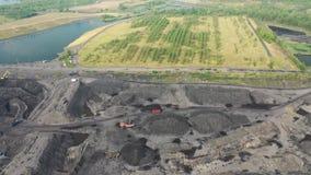 Czarny węgiel pyta, eliminacja żniwo czarny widoku z lotu ptaka coalmining zbiory wideo