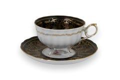 czarny złocisty teacup Zdjęcie Royalty Free