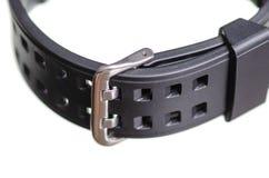 Czarny zegarek z gumowym bransoletka sportem makro- zdjęcia stock