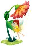 Czarodziejka pod gigantycznym kwiatem Zdjęcie Royalty Free