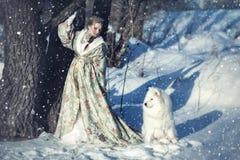 Czarodziejska dziewczyna z białym psem Obraz Stock