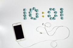 Czas, telefon i słuchawki Obraz Stock