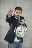 Czasu bohater, biznesowy mężczyzna i zegar, fotografia royalty free