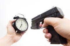 Czasu killing pistoletu krótkopędu zegar obrazy royalty free
