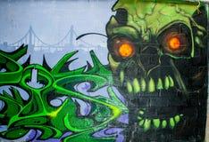 Czaszka potwora graffiti w zaniechanym fabrycznym budynku Zdjęcie Royalty Free